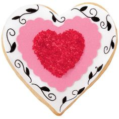 Sparkly Hearts Cookies - Show your loved ones how much you care by making a batch of these festive  cookies. Using Sugar Sheets!TM , Sparkling Sugar and FoodWriter Fine Tip Primary Colors Edible Color Markers, it's easy make these treats with plenty of time for extra hugs.