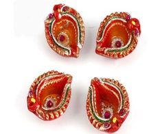 A set of four beautiful red diyas