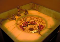 Golden Water Lily Sink - The Golden Water Lily Sink is a custom made glass mosaic sink with a lily flower pattern. One of the designer bath sinks by Cathleen Newsham.