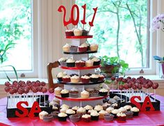 Graduation+Centerpieces+Ideas | made this black and red cupcake tower out of white cake boards and a ...