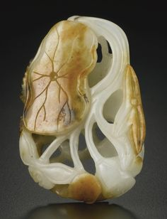 A CARVED WHITE JADE 'FISH AND LOTUS' PEBBLE, QING DYNASTY, 19TH CENTURY | Lot | Sotheby's