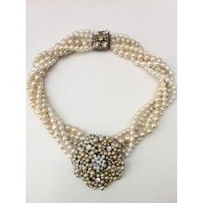5 string pearls in cream and ivory twisted with a stunning rhinestone and pearl pendant.