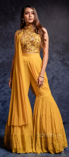 Turmeric yellow sharara set with a modish draped dupatta Party Wear Indian Dresses, Designer Party Wear Dresses, Indian Gowns Dresses, Indian Bridal Outfits, Dress Indian Style, Indian Fashion Dresses, Indian Designer Outfits, Designer Clothing, Sharara Designs