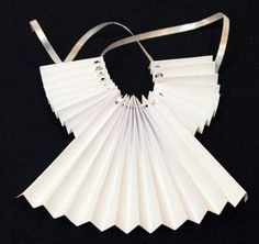 Accordian Folded Paper Angel Ornament Step 9 thread ribbon through holes