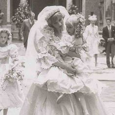 Princess Diana on her wedding day with bridesmaids and flower girls