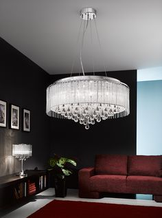 FL2161/8 Spirit large pendant fitting chrome and crystal glass. Chrome finish fitting with small crystal drops inside a Lurex fabric shade. Delicate glass rods surround the shade and teardrop shaped smooth glass drops hang beneth. Supplied with G9 mains voltage halogen bulbs which are suitable for dimming. 8 x 33w G9 Lamps Included Height- 150cm Minimum Height- 63cm Diameter- 60cm Weight- 9.5Kg BRAND: Franklite REFERENCE- FL2161/8 AVAILABILITY: 3-4 Working Days