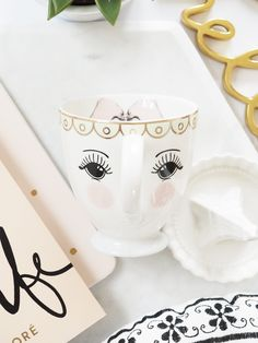 Gorgeous open eye coffee mug by Miss Etoile with a super cute bow detail inside.