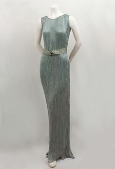 A Fortuny Delphos gown. I've seen one in my life. They are exquisite and timeless works of art. The secret of micro-pleating silk died with Fortuny.