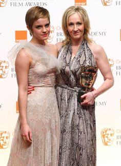 Emma Watson and JK Rowling pose in front of the winners boards at the Orange British Academy Film Awards 2011 held at The Royal Opera House on...