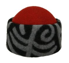 Felt hat. Tamga (brand of a tribe) series. The ornaments on the brim depict ancient Kyrgyz tamgas used to identify the clan. 100% wool, except the cotton lining and threads. Designed and handmade by Tumar Art Group.