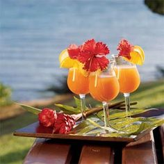 Enjoy this vibrant juice mixture with sparkling wine for a refreshing tropical mimosa., I would add champagne or several different rums!
