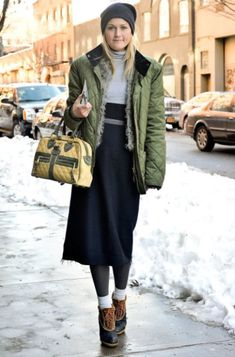 With midi skirt, puffer jacket, beanie and small bag