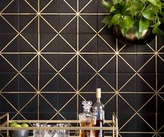 This Ellington tile mixes black and metallic gold for a trendy kitchen tile look. See what you can create with these gold tile accents in our latest blog.