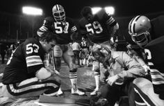 """""""Marty & His Boys"""" - 1981. Coach Marty Schottenheimer teaches as linebackers Bill Cowher, Clay Matthews, Charlie Hall, and Dick Ambrose ..."""