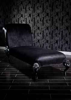 Black Baroque Chaise Lounge With Roses And Silver Accents - Lay back and relax peacefully on this incredibly romantic black-on-black chaise. The curled backrest and the beautiful roses on the legs are ornately hand-carved to make this incredible design. It is then upholstered in sumptuous velvet, and the frame is painted in a fabulous black and red finish, making it perfectly gorgeous and extremely comfortable.   68 IN W 29 IN D 39.5 IN H