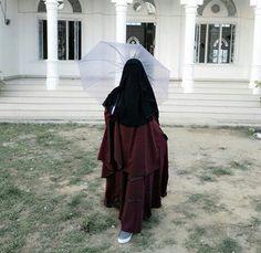 Niqabi in Maroon Jilbab with Umbrella