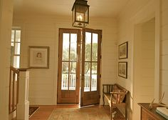Paint and pecan colored stain on floors Entryway - Found on Zillow Digs