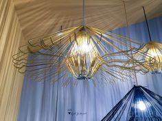 Look closer -- this mesmerizing chandelier is made from a grouping of simple wire hangers.