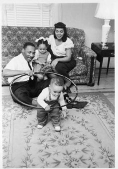 Candid photo of Martin Luther King with his wife Coretta and children