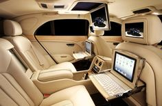 bentley... Just what everyone needs a laptop holder in case you get bored watching movies