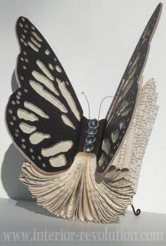 Blinging Butterfly Book Art - 20  Clever and Cool Old Book Art Examples, http://hative.com/old-book-art-examples/,