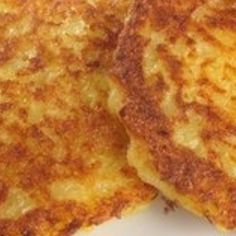 My sister used to visit me with a grocery bag containing potatos, flour, onions and sour creme. These are what she expected me to cook lol. Delicious little potato pancakes. Nana was polish and called them Placki Kartoflane.Poch was her maiden name lol cant get more polish than that . Serve with sour creme or apple sauce