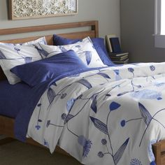 Fujiwo Ishimoto's interpretation of the stark beauty of Finland's Lapland scatters line drawings of blue vines, leaves and flowers on crisp white cotton percale.  Duvet has hidden button closure and interior fabric ties to keep insert in place.  Duvet insert also available. Designed by Fujiwo Ishimoto100% cotton percale300-thread-countHidden button closure and interior fabric tiesMachine wash cold, tumble dry low; warm iron as neededMade in Pakistan.