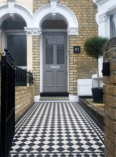 Grey front door. 70mm black and white victorian mosaic tile path with 50mm two inch diamond border