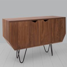 Bansho by Woodfeelings. With lines that provide an original shape, the Bansho sideboard consists of two doors integrated in the structure by means of a mechanism of hidden hinges, which hide four well distributed spaces.