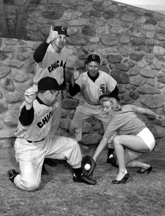 Marilyn Monroe posing with players at the White Sox training camp, March 1951.
