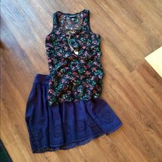Lace floral tank This tank has a cute, colorful, and flirty floral pattern with lace detailing. The front of the shirt has black lining, while the back is sheer. Never worn before. In great condition. If you're interested I can bundle or re-list item for reduced shipping!! ☺️ NO TRADES!! Self Esteem Tops Tank Tops