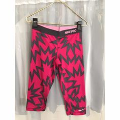 Nike Pro Dri-Fit pink patterned leggings About knee length, brand new, bought online wrong size for me, never been worn, tags prematurely taken off. Cute for workout, excellent condition. Nike Pants Leggings