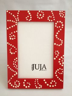 Wooden red frame with white dots Made by Juja.
