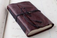 How to make a Leather Journal for drawing, painting, and doodles (tutorial + images via Cynthia Shaffer)