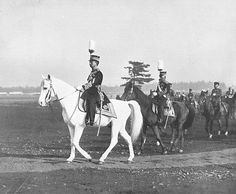 Emperor Showa, on his horse Shirayuki, reviewing Japanese Army troops, Feb 1933