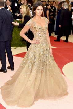 Nina Dobrev- Met Gala 2016 Red Carpet Fashion: In a gold Marchesa confection with cap sleeves and whimsical beading. (best dressed list)