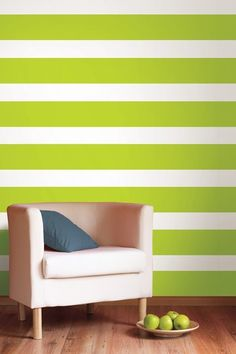 With another green color not white and green  get a few other colors and randomly place vertical strips on the wall