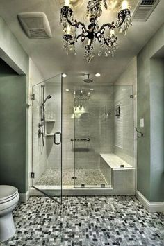A wet room takes a walk-in shower experience to the next level! Enjoy the full immersion of multi-head showers on either side and a rain shower above.