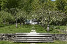 Marble steps descend to the house, crossing a narrow stream-fed rill. dan kiley at Currier Farm | gardenista