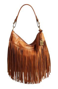 Adding some lavish fringe to the fall wardrobe with this beautiful curvy hobo bag made from silky soft leather.