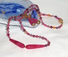 Set collana e orecchini in tormalina mulitcolore by Momentidoro, €150.00