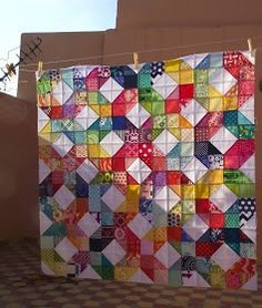 This cheerful scrap quilt was made for Project Linus. There is a link to the tutorial. Picture from Life's Rich Pattern blog..