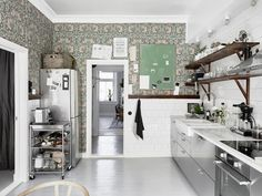A case of opposites attracting? Ikea stainless steel cabinets meet William Morris wallpaper in designer blogger Tant Johanna's eye-opening Gothenburg, Sweden, kitchen.