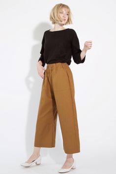 Jump into fall with the easy wide-leg Georgia Pant in Burnt Sienna! Wear with a slightly cropped top such as our Knotted Sweater to accentuate the waist. #fallfashion #winterfashion #streetstyle #minimalistfashion #madeinamerica #sweaters #sweaterweather