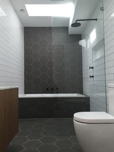 Hexagonal tiles. Monochrome bathroom. Matt black fittings. Natural Zebrano bathroom cabinet.