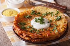 This potato rosti recipe will be your new favourite - it& so versatile and can be used for a variety of dishes. Crispy and delicious you& want it for brunch, breakfast and dinner. Top it with sour cream and smoked salmon, [. Potato Rosti Recipe, Potato Recipes, Vegetable Recipes, Potato Dishes, Crispy Potatoes, Vegetable Side Dishes, Side Dish Recipes, Food Processor Recipes, Breakfast Recipes