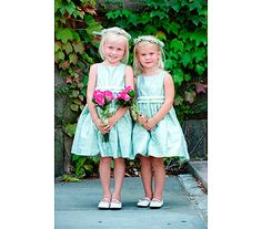 Tiny hand tied bouquets of roses for these little flower girls. We also made the babies breath halos.