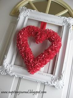 This is lovely.  It's a different idea in using the frame w/a wreath but I like it.  This or any other type of wreath or deco in the frame would look nice on a wall.