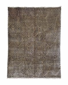 A Chinese carpet, 20th century. Approximately 11 ft. 7 in. x 8 ft. 9 in. (353 cm. x 267 cm.)