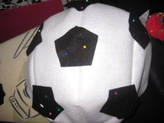 Pin, then sew or otherwise attach the pentagons to your costume.